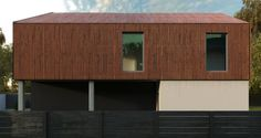 The wooden cladding of the upper level works wonders next to the dramatic white and black color scheme and panes of glass, meaning every angle looks dynamic and interesting. The border fence finished off with a dark stain makes sure the whole property is looking tip-top.  Houses by Мастерская Grynevich Dmitriy