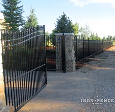 A beautiful property frontage accentuated by our 6ft tall wrought iron fence and 20ft wide arched driveway gate