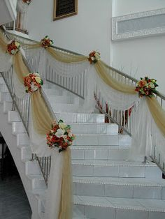 Use gold and white organza (wing around banister rather than hang from it) Add white lights winding around banister
