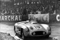 https://flic.kr/p/89GYUi | Fangio at the infamous 1955 Le Mans | This photo shows World Champion driver Juan Manuel Fangio at the tragic 1955 24 Hours of Le Mans.  This photo was taken before the disastrous crash in which Pierre Levegh careened off the course, killing more than 80 spectators.  Note how close the spectators were to the track.  When Levegh's Mercedes crashed the big engine was torn free and catapulted through the nearby crowd killing 80 and injuring at least a hundred.  They…