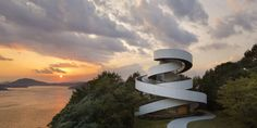 """Completed in 2013 in Hiroshima, Japan. Images by Koji Fujii / Nacasa & Partners Inc. Two Spirals Become One This wedding chapel stands in a garden of a resort hotel, """"Bella Vista Sakaigahama,"""" in Onomichi, Hiroshima. Architecture Design, World Architecture Festival, Religious Architecture, Amazing Architecture, Contemporary Architecture, Japan Architecture, Building Architecture, Sustainable Architecture, Building Design"""