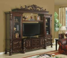 """5 pc medium finish wood entertainment center wall unit with carved accents and side cabinets with bridge with crown carving. This set includes the TV stand, 2 side towers closed bottom cabinets and glass front doors on top, Center shelf and top Bridge unit. Unit measures 114"""" x 97"""" H x 23 1/2"""" Deep. Tv stand alone measures 56"""" x 23 1/2"""" x 27 1/2"""" H. Some assembly may be required. SKU E7601"""
