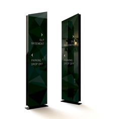 Vehicular directional signage in steel and glass.