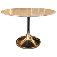 1970s Italian Tulip Base Round Marble Table | From a unique collection of antique and modern tables at https://www.1stdibs.com/furniture/tables/tables/