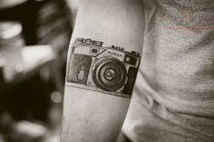 Nikon Camera Tattoo On Arm