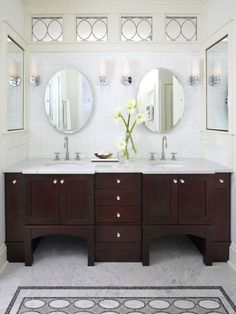 Splendid bathroom with espresso stained wood double bathroom vanity with white carrara marble countertop, oval pivot mirrors, inset medicine cabinets, ivory walls & molding, marble tiles floor with mosaic inset tiles and white linear tiles backsplash. White Marble Countertops, Home, Double Vanity Bathroom, Bathroom Makeover, Bathroom Vanity, Bathroom Decor, Modern Style Decor, Bathroom Inspiration, Vanity Design