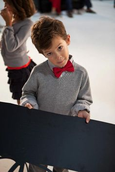 Pop of red: How cute is Walker's red bow tie? He had a blast during our #holiday photo shoot.
