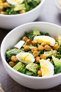 Totally Addicting Vegetarian Kale Salad with avocado, crispy chickpeas, hard boiled eggs and toasted quinoa