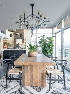 Tile work, globe chandelier + large wooden dining table