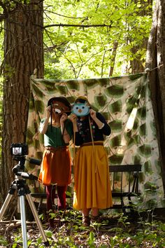 Smile Booth. Snap some pics of all the party animals in front of a woodland print drape with a camera and tripod.
