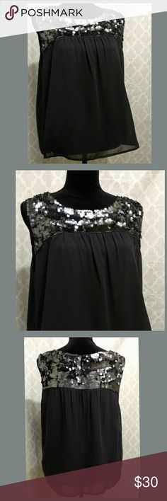 NWOT. LOFT Blouse w/ Sequins! NEW without tags.  Purchased, took the tags off and was going to wear for New Year's, but didn't. (I did wash the blouse.)   Excellent condition; never worn.   Beautiful sequins on the top, neckline, shoulders. Light and flowy; the material feels chiffon-like.  Small key-hole w button closure on the back of the neck.  The color is a navy-gray-ish/ charcoal-blue.   SIZE: Petite XL LOFT Tops Blouses