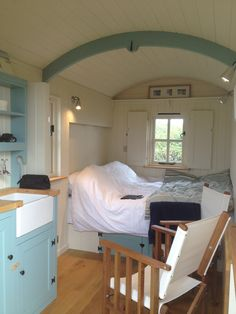 Beside the seaside - double bed and kitchen dresser. A Plankbridge hut.