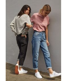 URBAN OUTFITTERS: White long-sleeve shirt, black mom jeans, white sneakers  / pink t-shirt, blue mom jeans, white sneakers