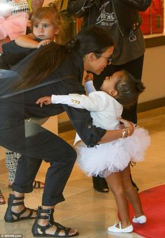 Aunt Kourt! The reality star had her hands full with a tot in each arm...