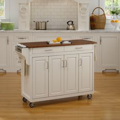 This attractive cart from Home Styles features a white finish with a three quarter inch oak finished wood top. In addition, this piece features a durable, solid wood construction and wheels for mobility.