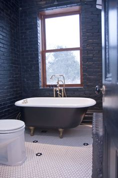 love the black brick....  traditional bathroom by Jenn Hannotte / Hannotte Interiors