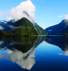 Visit World Heritage Site Milford Sound, a fjord in New Zealand.