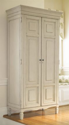 Distressed off-white armoire for the bedroom!