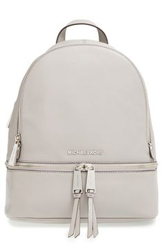 Free shipping and returns on MICHAEL Michael Kors 'Small Rhea Zip' Leather Backpack at Nordstrom.com. Gleaming exposed zippers trace the compact silhouette of a structured shoulder bag cut from color-pop pebbled leather. Raised silvertone logo letters serve as a signature signoff.