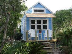 a little beach cottage on wheels by signatour tiny houses. www.tinyhousetalk.com
