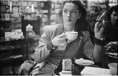 Stanley Kubrick, Rosemary Williams, show girl, drinking coffee and smoking a cigarette, 1949