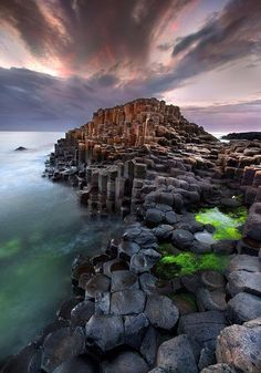 The Giant's Causeway, Northern Ireland. it is an area of about 40,000 interlocking basalt columns up to 12m tall, the result of an ancient volcanic eruption. The tops of the columns form stepping stones that lead from the cliff foot and disappear under the sea.