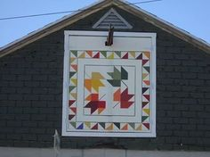 """120 South Kalamazoo Their historic family barn was built by Bill's grandfather and everyone just called it """"the barn on Kalamazoo."""" Ruthie painted the barn quilt in her shop around the corner on Main St., Ruthie's Paint & Yarn Shoppe.  Shared on Vicksburg Quilt Trail Facebook page"""