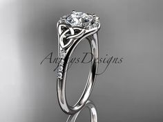This is gorgeous platinum diamond floral wedding ring engagement ring with a Forever One Moissanite center stone ADLR It has VS-SI G color diamonds total weight of ct The center Celtic Engagement Rings, Unique Diamond Engagement Rings, Celtic Wedding Rings, Engagement Wedding Ring Sets, Diamond Rings, Diamond Jewelry, Platinum Wedding Rings, White Gold Wedding Rings, Diamond Wedding Bands