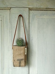 Etsy seller season turns burlap that used to hold coffee into these handy planter bags that you can use to hang out with your plants.