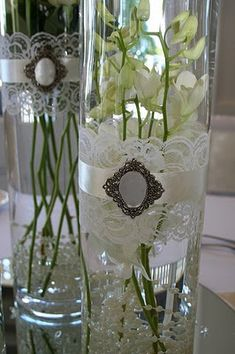 Vintage lace vases with a brooch.