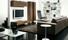 Tv wall idea also built in could do.like the black floor brown couch change white to cream. Add marble stone & black stone with glass tile to inside shelves with accent lights. Add drop down table.