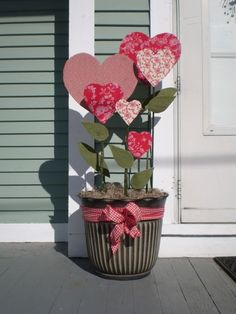 A pot of fabric-covered hearts for indoors or outdoors ~ cardboard or foam core for hearts.