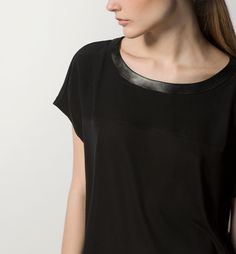 TOP WITH LEATHER NECKLINE