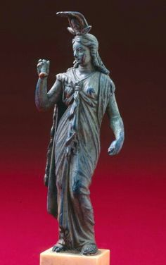 Green and brown patina figure of Isis. Roman. Imperial Period. 1st - 2nd century A.D. | Museum of Fine Arts, Boston