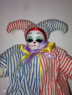 miniature porcelain clown doll in red white & blue striped