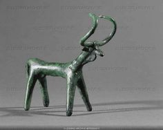 Bovine animal. Small bronze statue. From tomb 507, Hallstatt Archaeological Site, Austria. Height 9.7 cm (c) Photograph by Erich Lessing