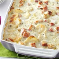 "White Cheddar Scalloped Potatoes Recipe -This recipe has evolved over the past eight years. After I added the thyme, ham and sour cream, my husband declared, ""This is it!"" I like to serve this rich, saucy entree with a salad and homemade French bread. —Hope Toole, Muscle Shoals, Alabama"