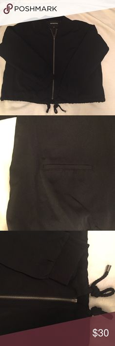 NWOT Black Bomber Jacket Black bomber style jacket. Decorative pockets on the front. Drawstrings to cinch in Jacket at the bottom. Never worn, but tags have been removed. who what wear  Jackets & Coats Utility Jackets