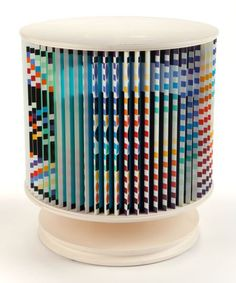 YAACOV AGAM (Israeli, b. 1928) Agamorama (Accelerated Rhythme) Polychromed wood and laminate with rotating mechanism 30-1/8 x 28 x 28 inches (76.5 x 71.1 x 71.1 cm) Ed. 5/180 Signed in gold pen at base at cylinder: Agam