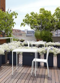 The Grillage outdoor bistro table, stocked in Black and White. x 70 x 70 cm