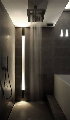 Modern bathroom with shower and bathtub. #modernbathroom #bathroomdecorideas
