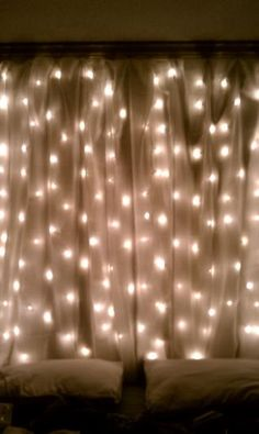 Bedroom lighting - string lights behind sheer curtains. Would love to do this behind a short bookcase when I redo my room! Bedroom Lighting, Bedroom Decor, Bedroom Ideas, Bedroom Curtains, Warm Bedroom, Patio Curtains, Curtain Lights, Curtains With Lights, Luminaire Design