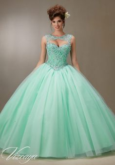 Quinceanera dresses by Vizcaya Embroidery and Beading on a Tulle Ball Gown Removable Keyhole Coverlet and Matching Stole included. Colors: Scuba Blue, Cotton Candy, Mint, White.