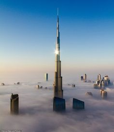 Dubai Skyline, Burj Khalifa, tallest building in the world merges through fog. In Dubai, Dubai City, Dubai Uae, Dubai Skyline, Foto Poster, Dubai Skyscraper, Dubai Travel, Best Hotel Deals, Nature Photography