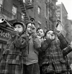 "January 1, 1943. ""New York. Blowing horns on Bleecker Street on New Year's Day."" Photo by Marjory Collins"