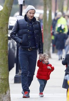Harper Beckham runs things! More cute pics of her and David in London here.