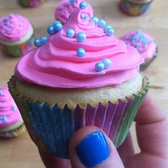 Colorful cupcakes paired with @Essie Martin's 'avenue maintain.'