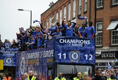 The Chelsea team celebrate from an open top bus during the Chelsea victory parade following their UEFA Champions League and FA Cup victories on May 20, 2012 in London, England.  (May 19, 2012 - Source: Steve Bardens/Getty Images Europe)