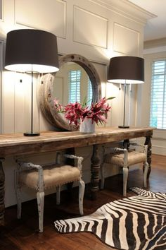 Love the antique sideboard & mirror against the traditional wall of wainscoting...  (500×752)