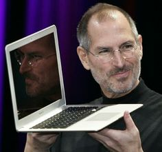 PHOTO: Apple CEO and co-founder Steve Jobs shows off the new Macbook Air ultra portable laptop during his keynote speech at the MacWorld Conference & Expo in San Francisco, Calif. Steve Jobs Apple, Apple Inc, Alter Computer, Steve Wozniak, New Macbook Air, Macbook Pro, Star Wars, Branding, High Fashion